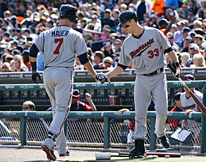 Joe Mauer (left) is congratulated by Justin Morneau after hitting a home run in the first inning. (USATSI)