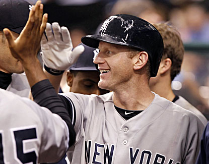 Lyle Overbay celebrates with his teammates after he homers with two outs in the 11th inning. (USATSI)