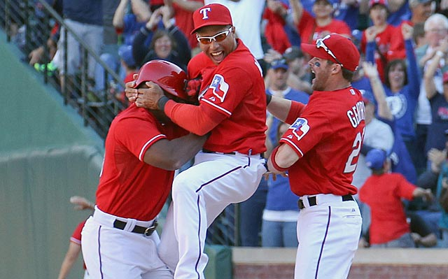 The Rangers are getting along just fine with Leonys Martin (center) and Craig Gentry (right) sharing center field.