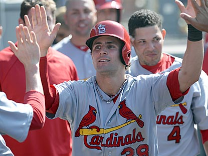 Pete Kozma receives congratulations after scoring the Cardinals' go-ahead run during the seventh inning.  (USATSI)