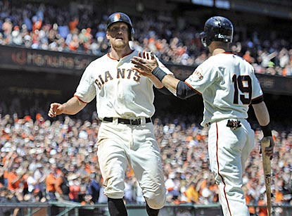 Hunter Pence (left) and Marco Scutaro score the go-ahead runs for San Francisco on Brandon Belt's double in the fifth inning.  (USATSI)