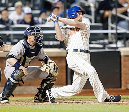 Daniel Murphy follows through on his RBI single in the eighth inning, which puts the Mets in front for good.  (USATSI)