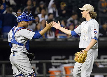 Welington Castillo (left) congratulates Jeff Samardzija on his first major-league shutout. Samardzija faces only 30 batters.  (USATSI)