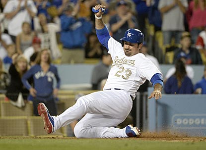 Adrian Gonzalez slides home with the go-ahead run in the seventh inning. Gonzalez winds up 4 for 4 with four runs scored.  (USATSI)