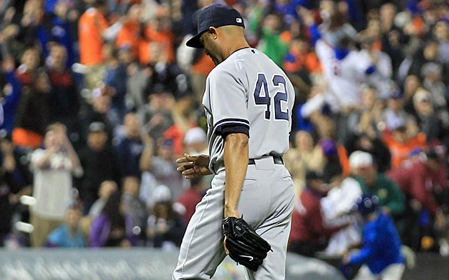 Mariano Rivera walks off after allowing three consecutive hits without getting an out.