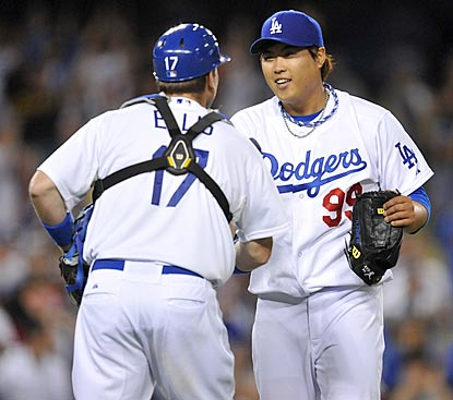 Dodgers catcher A.J. Ellis is the first to congratulate Hyun-Jin Ryu on his first MLB complete game.  (USATSI)