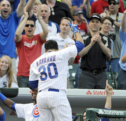 Cubs fans cheer on Dioner Navarro, who produces six RBI off a career-best three home-run outing. (USATSI)