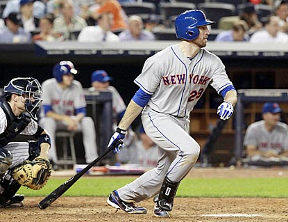 You know things are going the Mets' way when slumping Ike Davis delivers a two-run single against the Yankees.  (USATSI)