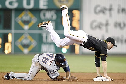 Despite Torii Hunter's efforts to disrupt him, Pittsburgh's Neil Walker successfully turns a double play in the seventh inning. (USATSI)
