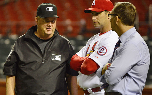 Give Joe West credit for waiting Thursday night, denying the Cardinals a tainted victory. (USATSI)