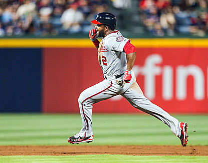 Denard Span legs out a triple for one of his three hits in the Nats' 3-2 win over Atlanta. (USATSI)
