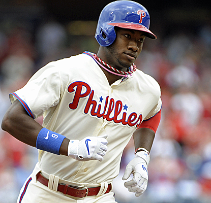 Domonic Brown finishes a double shy of the cycle as the Phillies hold off the Brewers on Sunday.  (USATSI)