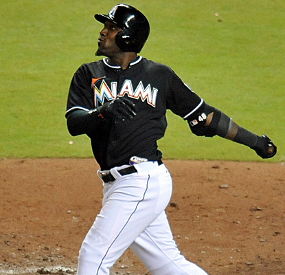 Marcell Ozuna tallies three hits and four RBI, and the Marlins finish off a sweep of the Mets.  (USATSI)