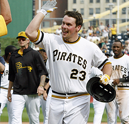 Travis Snider is congratulated after knocking home the winning run with a two-out single in the 11th inning.  (USATSI)