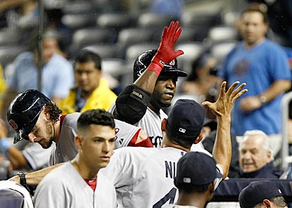 David Ortiz greets the Boston welcoming committee after launching a home run in the sixth inning. (USATSI)