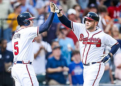 Freddie Freeman (left) and Brian McCann each leave the yard to help the Braves achieve their 13th three-homer game of 2013.  (USATSI)
