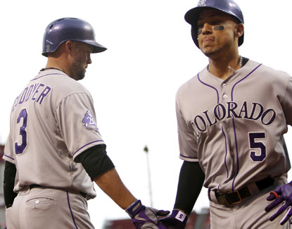 Carlos Gonzalez ties his career high with three of Colorado's six homers as they easily defeat the Reds. (USATSI)