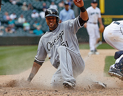 Alex Rios scores in the 14th inning and also contributes an RBI single for the White Sox in the decisive 16th inning. (Getty Images)