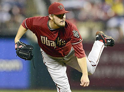 After two rough outings, Arizona's Wade Miley scatters 11 hits in 6 2/3 innings and earns his first victory since May 8.  (USATSI)