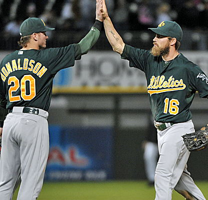 Josh Donaldson hits a grand slam, and Josh Reddick makes a game-saving catch as the A's pick up the win.  (USATSI)