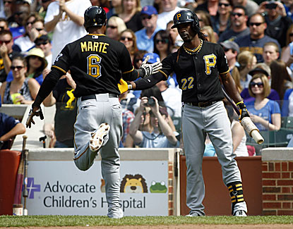 Starling Marte comes around to score for Pittsburgh to back a strong outing from A.J. Burnett. (USATSI)