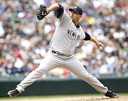 Andy Pettitte allows just three hits over 7 1/3 innings against the Mariners and earns his 250th career win. (USATSI)