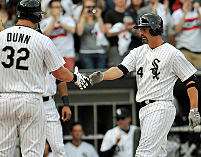 Paul Konerko meets Adam Dunn at home after hitting a two-run home run during the eighth inning. (USATSI)