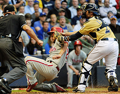 Milwaukee catcher Jonathan Lucroy puts the tag on Philadelphia's Kevin Frandsen in the sixth inning. (USATSI)
