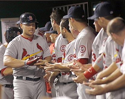 Matt Holliday goes down the reception line after belting his game-clinching grand slam in the 10th inning.  (USATSI)