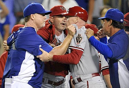 A testy 1980s reunion: Mark McGwire (left) confronts Matt Williams; managers Kirk Gibson and Don Mattingly (right) intervene.  (USATSI)