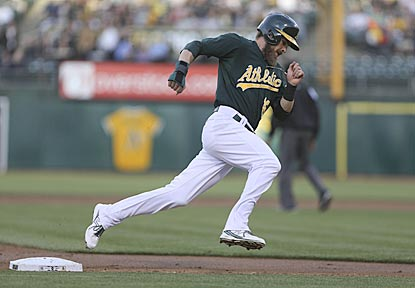 Oakland's Josh Reddick races home and scores on Derek Norris' double in the second inning.  (USATSI)
