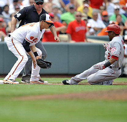Erick Aybar slides into third with a bases-clearing triple, then scores when the throw gets past Manny Machado.  (USATSI)