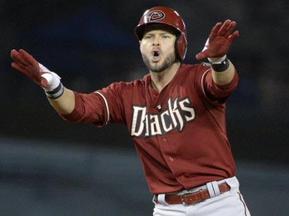 Cody Ross celebrates after leading off the 12th inning with a double. He soon scores on Martin Prado's double.  (USATSI)