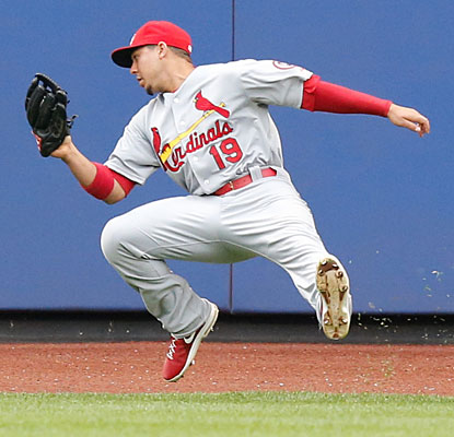 After getting twisted around, Cards center fielder Jon Jay makes a falling catch.  (USATSI)