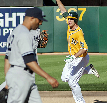 Nate Freiman celebrates after hitting the game-winning single off Mariano Rivera in the 18th inning.  (USATSI)