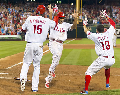 Ben Revere, who begins the Phils' ninth-inning comeback with a single, scores the winning run as they rally past the Nats. (USATSI)