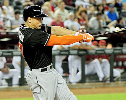 Giancarlo Stanton goes yard twice and drives in all of the Marlins' runs in Miami's comeback effort. (USATSI)