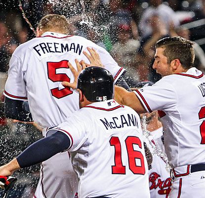 Teammates maul Freddie Freeman, who clubs the game-winning home run to seal Atlanta's come-from-behind win. (USATSI)
