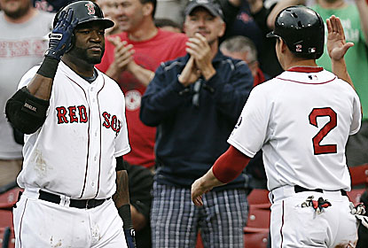 David Ortiz drives in three in the DH's first game, which is delayed nearly three hours because of rain. (USATSI)