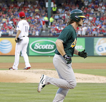 A's catcher John Jaso rounds the bases after going yard off Yu Darvish in the third inning. (USATSI)