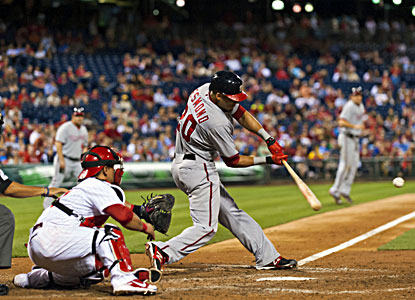 The Nationals' Ian Desmond hits a grand slam during the 11th inning against the Phillies. (USATSI)