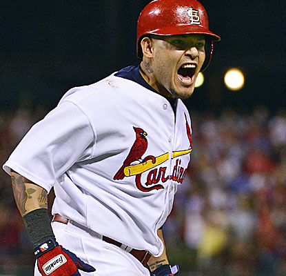 Beside his great work with the bat, catcher Yadier Molina also guides the excellent pitching staff. (USATSI)