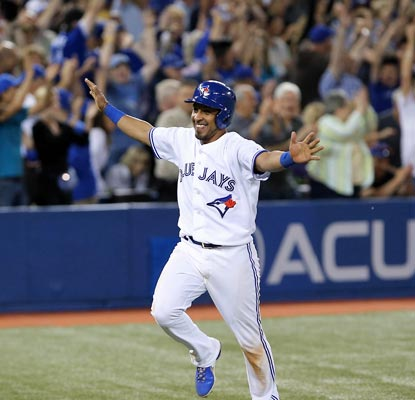 Macier Izturis comes home for the winning run as the Blue Jays reach the .500 mark with a 36-36 record.  (USATSI)
