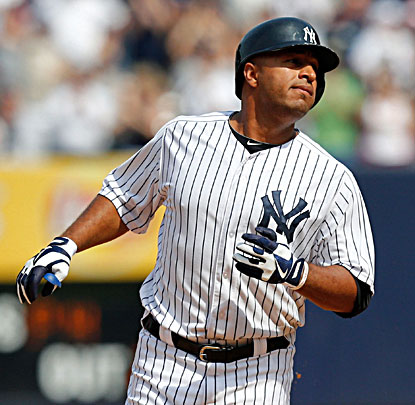 Vernon Wells watches after hitting a  pinch-hit, three-run double during the seventh inning. (USATSI)