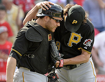 Pirates closer Jason Grilli gives up three runs on five hits in the 10th, but hangs on to preserve the win. (USATSI)