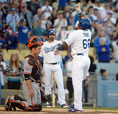 Yasiel Puig, who faces the Giants for the first time, introduces himself with a home run in his first at-bat. (USATSI)