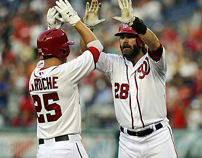 Washington's Adam LaRoche (three hits) celebrates his three-run homer with teammate Jayson Werth. (USATSI)