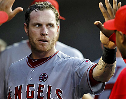 Josh Hamilton, struggling for most of the season, scores three runs to go with three hits in the Angels' win. (USATSI)