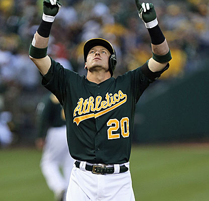 Third baseman Josh Donaldson hits a two-run homer for the A's in their victory over the Cincinnati Reds. (USATSI)