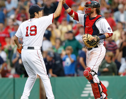 Excitable Boston closer Koji Uehara pitches a perfect ninth for the Red Sox, striking out two and picking up his second save. (USATSI)
